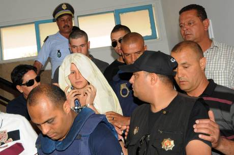 Amina Sboui appears handcuffed at courthouse in Kairouan