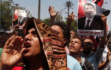 Protesters, who support former Egyptian President Mohamed Mursi, march near Cairo University in Cairo