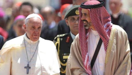 Pope Francis is welcomed by Jordan's Prince Ghazi bin Muhammad upon his arrival in Amman