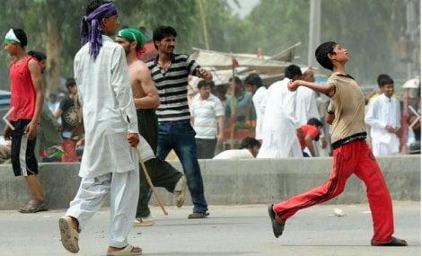 (AFP Photo/Asif Hassan )