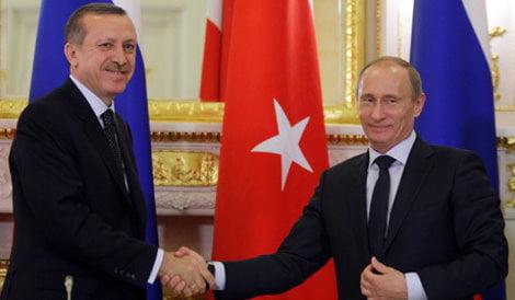 Russian Prime Minister Vladimir Putin meets with Turkish Prime Minister Tayyip Erdogan