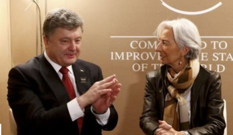 Lagarde, head of the International Monetary Fund (IMF) meets with Ukrainian President Poroshenko in the Swiss mountain resort of Davos