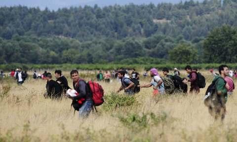 migranti fuggono dalla quarantena